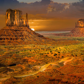 Mittens by Mark Franks - Landscapes Sunsets & Sunrises ( navajo nation, clouds, monument valley, orange, red rock, sunrise, glow )