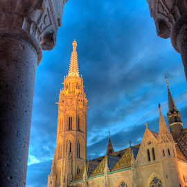 Church of Mathias Rex in Budapest, Hungary by Péter Mocsonoky - Buildings & Architecture Places of Worship ( famous, old, europe, gothic, rex, stone, architecture, travel, bastion, capital, attraction, religion, sky, style, cloudy, monument, st, evening, light, clouds, hungary, building, budapest, church, tourism, mathias, dusk, hungarian, history, roof, urban, landmark, tower, european, blue, cathedral, night, castle, matthias, buda )