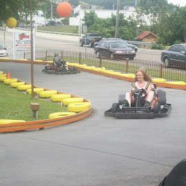 Riding go carts ! by Linda Blevins - City,  Street & Park  Amusement Parks ( amusement park, track, go cart )