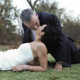 Kiss on the Grass by Lodewyk W Goosen-Photography - Wedding Bride & Groom ( love, pose, kissing, wedding, bride, marriage, groom )