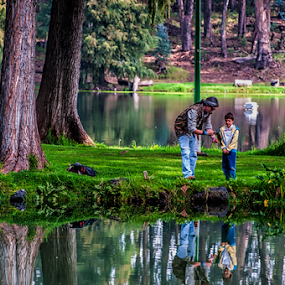 Fishing by Cristobal Garciaferro Rubio - People Family ( dad, fishin reflecions, fish, boy, kid )