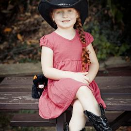 Cowgirl & Kitty by Joseph Humphries - Babies & Children Child Portraits ( love, blueeyes, crossinglegs, dress, braid, cowboyhat, cowgirl, pink, redhead, smile, boots, hat )