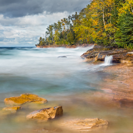 Pictured Rocks Surf by Kenneth Keifer - Landscapes Beaches ( miners beach, rock, beach, leaves, pure michigan, nature, autumn, foliage, surreal, surf, boulders, national lakeshore, midwest, horizon, forest, lake, elliot, upper peninsula, trees, cataract, shore, colorful, waterfall, blur, coastline, landscape, coast, miner's, shoreline, cloudy, crashing, long exposure, water, clouds, waves, munising, sea, lake superior, seascape, great lakes, scenic, woods, blurred, michigan, national park, color, cascade, falls, fall, cascading, october, whitewater, pictured rocks, miners )