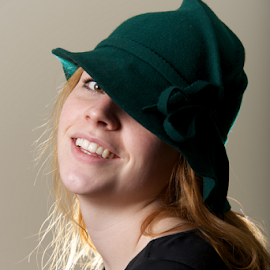 Redhead in green hat with head tilted by Nick Dale - People Fashion ( tilted, girl, green, woman, redhead, head, black, portrait, smiling, hat )