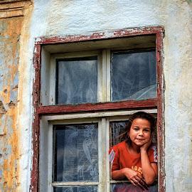 The girl in  the window by Mirela Savu - Babies & Children Child Portraits ( girl, village, window, street, innocence,  )