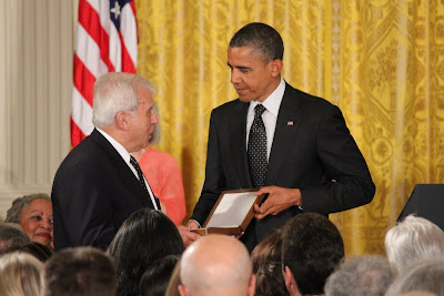Former Polish foreign minister Adam Daniel Rotfeld accepts the Presidential Medal of Freedom for Jan Karski from US President Barack Obama, 29 May  2012.