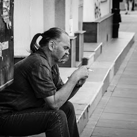 Bad habits by Cassandra G - People Portraits of Men ( cigarette, black and white, smoking, street, candid, mustache, man, city )