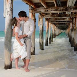 Under the Bridge by Andrew Morgan - Wedding Bride & Groom ( love, kiss, zanzibar, wedding, sea, bridge, paradise )