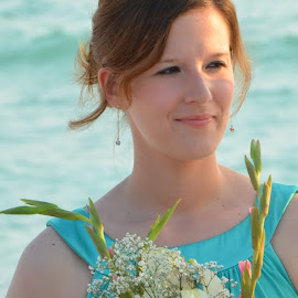 The beautiful Maid of Honor at the Florida wedding, very deep in thought. by Carmella Dunkin - Wedding Ceremony ( maid of honor, floral bouquet, flower bouquet, flowers, beach wedding, floral, brides maid, flower, bouquet )