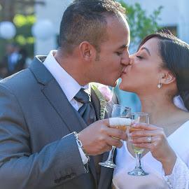 by Randall Langenhoven - Wedding Bride & Groom ( love, kissing, wedding, couple, bride, groom, together )