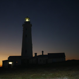 Lighthouse Cape St Francis by Ernst Kotze - Buildings & Architecture Other Exteriors ( building, silhouette, sunset, lighthouse, old building, rocks, light,  )