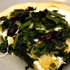 Pizza with Broccoli Raab, Roasted Onions and Olives