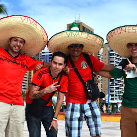 Mexican fans in the football World Cup by Suelena Moreira - People Portraits of Men