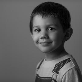 little man by Michael Otero - People Portraits of Men ( singlelight, flash, nikondf, df, 135mm, shootthrough, nephew, umbrella, doesntfilm, nikon, portrait,  )
