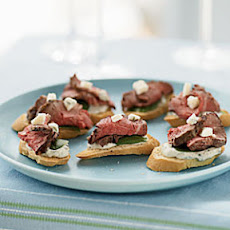 Beef and Gorgonzola Toasts with Herb-Garlic Cream