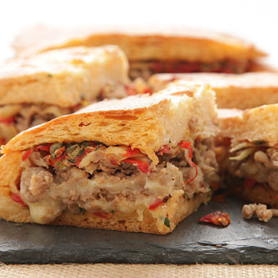 Italian Sausage and Fontina Shooter's-Style Sandwich With Onions, Peppers, Fennel, and Sun-Dried Tomato-Caper Relish
