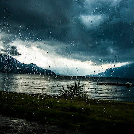 Drops on the glass by Kwa Klok - Landscapes Underwater ( clouds, hills, mountains, glass, drops, lake, raindrops, landscape, storm, rain )
