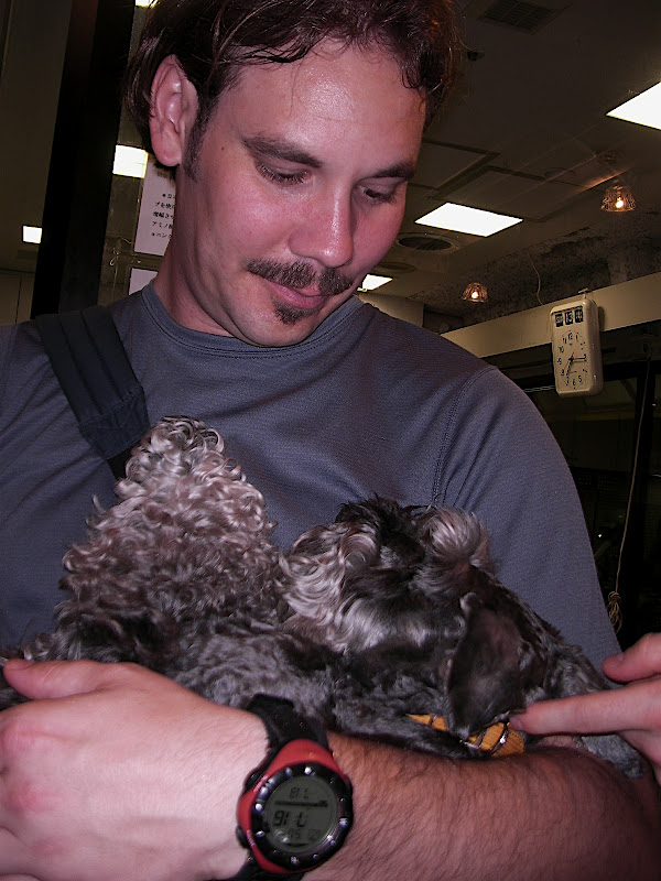 Jason holding the calm Schnauzer
