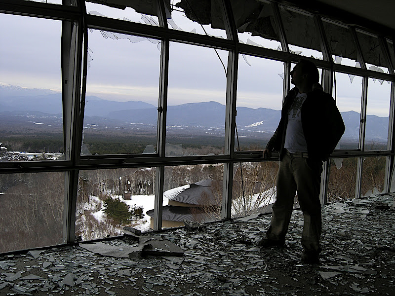 Mike takes in the view upon shattered window shards