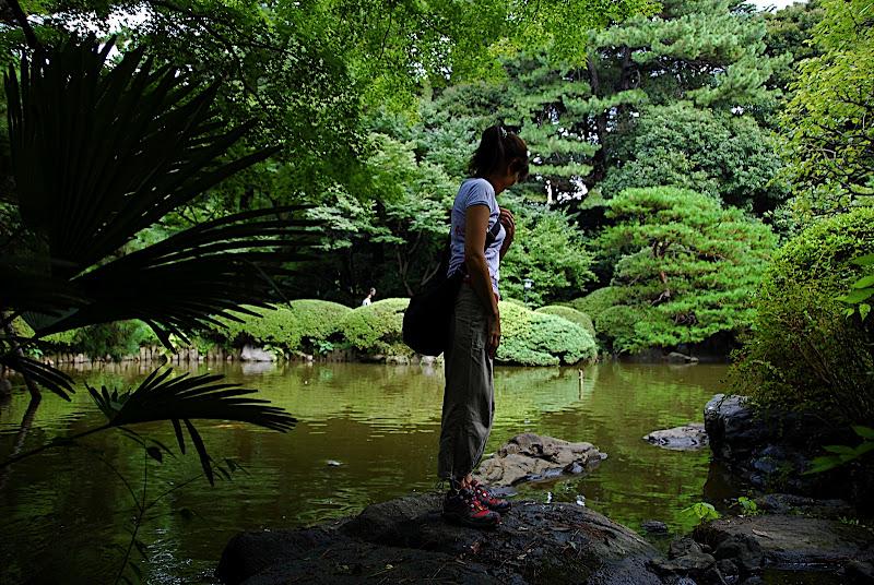 Aya looking at the coy in Shizen Kyoiku Park