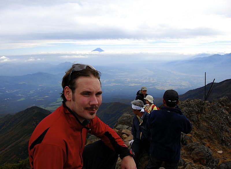 Jason taking a break on the summit of Akadake