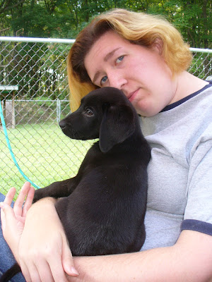 Maria and a black Lab.