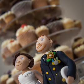 Wedding Toppers Guarding the Cupcakes by Anthony Ashcroft - Wedding Details ( cake, topper, statue, figure, cupcakes, wedding, icing, photographer, white, navy, bride, groom )
