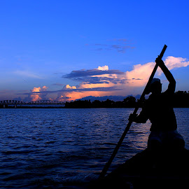 'Pull thy Oar'... by Kamelia Dandapat - Landscapes Travel ( clouds, west bengal, sky, rowing, blue, silhouette, ganges, india, travel, boat, evening, river,  )