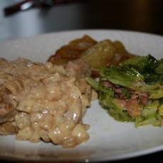 Pork Fillet In Creamy Apple Sauce With Cabbage And Bacon