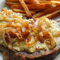 Pub Style Peppered Stilton Steaks With Charred Onions and Chips