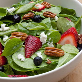 Baby Spinach with Fresh Berries, Pecans and Goat Cheese in Raspberry Vinaigrette