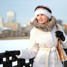 Girl in winter city by Feliks Kuchmakra - People Portraits of Women ( seafront, home, face, person, cap, collar, brooch, people, hat, city, sight, sky, girl, woman, ice, snow, fur, cheliabinsk, metallic, smile, coat, garments, look, handbag, clothes, likeness, bag, image, photo, portrait, roof, picture, winter, russia, season, female, freeze, lady, glove, town, bridge, embankment, river )