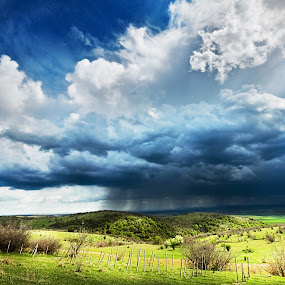 Rain Storm by MIhail Syarov - Landscapes Cloud Formations ( dynamic, clouds, field, fence, sky, grass, blue, green, storm, landscape, rain, rural,  )