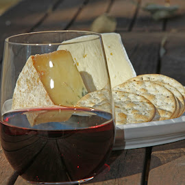 Cheese and wine picnic by Chris Smith - Food & Drink Meats & Cheeses ( wine, red wine, outdoor, wine glass, plate, crackers, cheese, sunlight, picnic )