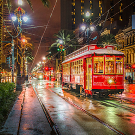 New Orleans Canal St 1 by Sheldon Anderson - Transportation Trains ( new orleans, red, night photography, street car, rain, nightscape )