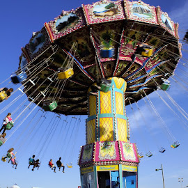 Lets  Go For a Swing by Jo Gonzalez - City,  Street & Park  Amusement Parks ( blue sky, swing ride )