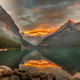 Lake Louise Morning Glory by Joseph Law - Landscapes Waterscapes ( lake louise, national park, bushes, boats, rocky mountains, morning glory, reflections, trees, rocks, banff )