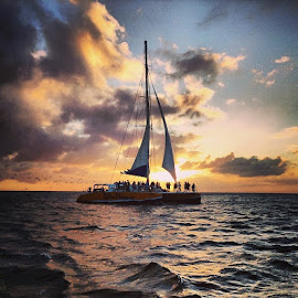 by Megan Peets - Instagram & Mobile iPhone ( sunset, clouds, beautiful, sailboat, surreal, aruba )