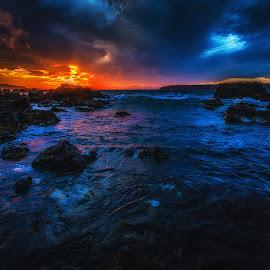 Last Red On the Sea by Stewart Baird - Landscapes Sunsets & Sunrises ( water, sea, sxbaird, stewart baird, seascape, titahi bay, landscape, new zealand, red, sunset, www.stewartbaird.com, pink, rocks )