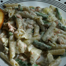 Salmon Penne With Basil Pesto Cream Sauce, Artichokes, and Asparagus