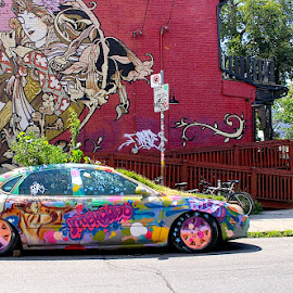 Mercroo by Ronnie Caplan - City,  Street & Park  Neighborhoods ( building, colourful, streetscene, automobile, greenery, graffit )