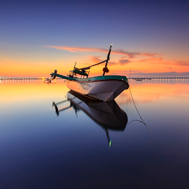 Shaky Boat Captain by Yudik Pradnyana - Transportation Boats ( water, bali, waterscape, sunris, cloud, boat, landscapes )