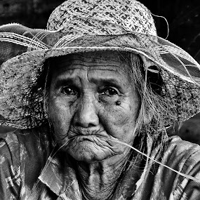 Grass in the mouth by Rafael Widya Wiryawan - People Portraits of Women