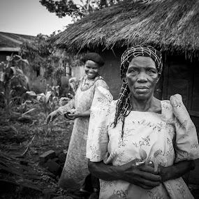 Village Life by Georgia Darlow - People Portraits of Women ( uganda, village, black and white, woman, house, portrait,  )
