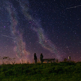 The Meeting Place by Srdjan Vujmilovic - Landscapes Starscapes ( milkyway, girls, person, grass, colorful, nightshot, colors, star, falling, people, photo, photography, nightscape, girl, life, night photography, color, stars, meeting, dark, night, place, creativity, lighting, art, artistic, purple, mood factory, lights, fun, , vibrant, happiness, January, moods, emotions, inspiration )