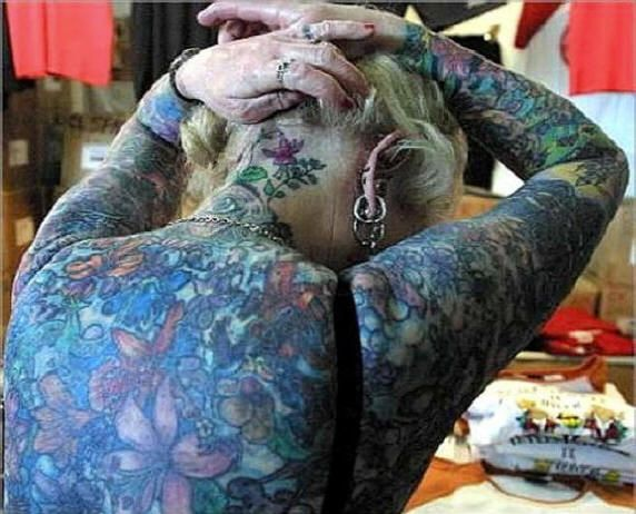womans sexy and weird body tattoo