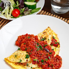 Italian Sausage and Roasted Red Pepper Omelette Topped with Marinara Sauce