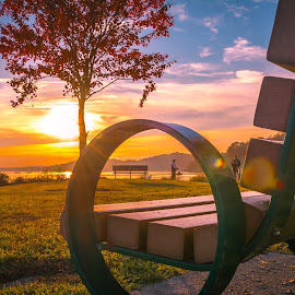 Sunsets, Fall and public bench by IMade Budaryawan - City,  Street & Park  City Parks ( public park, sunset fishing, benches, sunset, fall, fishing )