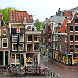 typical Dutch Housing and shops on Amsterdam Canal... by Berys McEvoy - Buildings & Architecture Office Buildings & Hotels