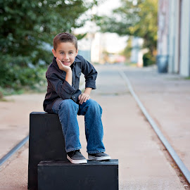 Coen by Carole Brown - Babies & Children Child Portraits ( brown eyes, little boy, tracks, brown hair, posing, apple boxes )